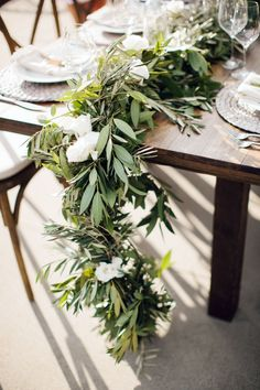 Lush green garland: http://www.stylemepretty.com//living/2015/03/14/25-ways-to-work-green-into-your-home/