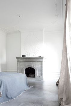 Classical marble fireplace with minimal interior by Dannish office Norm Architects.