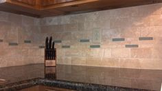 backsplash ideas for ubatuba countertop | ... Tile Installation – Uba Tuba Granite – Travertine Backsplash