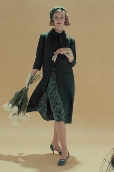 March 1958    Model is wearing a coat with the same fabric lining as the dress she wears beneath.
