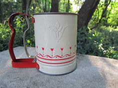 Hey, I found this really awesome Etsy listing at https://www.etsy.com/listing/448802736/flour-sifter-with-red-tulip-design-hand