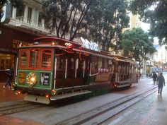 Cable cars in San Francisco...Not electric traction, but the cable is run by electricity...close enough...