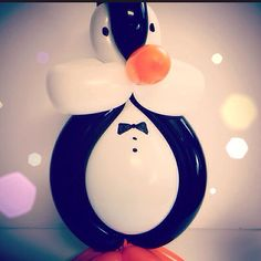 Photo by heatherdnewton April 8: Balloon animals have become a quite rewarding {hobby} for me. It's amazing how happy they make people! This chubby penguin is one of my recent faves  #fmsphotoaday