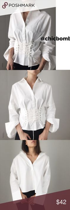 """Theori modern chic lace up shirt . High end / quality crisp shirt with a twist. Corset lace up shirt for the fashionista. Statement piece for fall 2017. I'm wearing size s for the cover shots.  Thick dense material non sheer fabric. The cutting is extra wide for different styling.. with or without lace up. After lace up size S bust 34"""", length 28"""", size M bust 35@, length 28"""". Size L bust 36@ , length 29"""". CHICBOMB Tops Button Down Shirts"""