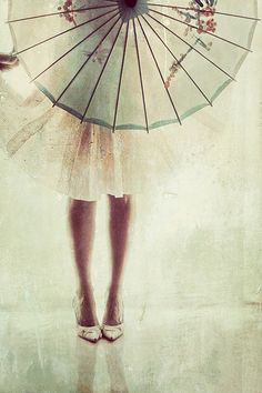 A pretty and feminine celadon green parasol would make a lovely prop for your wedding photos.