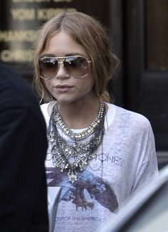 mary-kate in a rolling stones tee and some awesome bling