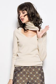 <p>Soft-touching fabric. Short style. Long sleeve. Turtle neck. V back or front just depends. About me:. 50%Viscose 30%Chinlon  20%Draw textured yarn</p>