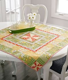 A simple Pinwheel block is quite a star when it's surrounded by multiple  borders—pieced and plain.