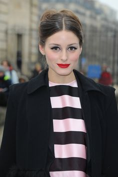Olivia Palermo went for classic red lips and a center part up-do during Paris Fashion Week