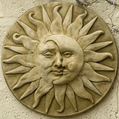 Garden plaque sun moon face - beautifully done