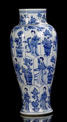 Agood blue and white porcelain vase with beauties and boys near flower pots, China, leaf mark, Kangxi period.