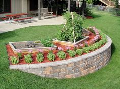 A yard with a steep slope can be difficult to landscape. Build a block retaining wall to add level tiers to your yard, which prevent erosion and provide a perfect place for a flower garden. Small Vegetable Gardens, Starting A Vegetable Garden, Vegetable Garden Design, Garden Landscape Design, Sloped Yard, Sloped Backyard, Backyard Ideas, Backyard Retaining Walls, Building A Retaining Wall