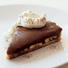 Milk Chocolate Banana Pie | This incredible pie has a hazelnut crust, which balances out the sticky, sweet filling.