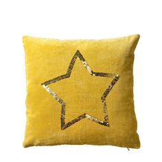 yellow velvet cushion with golden sequin star from Bloomingville. www.bloomingville.com