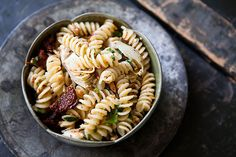 Fusilli pasta tossed with marinated artichoke hearts, sun-dried tomatoes, and toasted almonds.