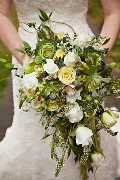 Cascading bouquet idea - lush green + white bouquet with roses + greenery {Courtney Bowlden Photography}