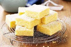 These moist Lemon Brownies use just a few ingredients and are ready in no time at all. Don't miss the Lemon Coconut Brownies, they're delicious! Lemon Desserts, Lemon Recipes, No Bake Desserts, Sweet Recipes, Baking Recipes, Dessert Recipes, Tropical Desserts, Dessert Bars, Lemony Lemon Brownies