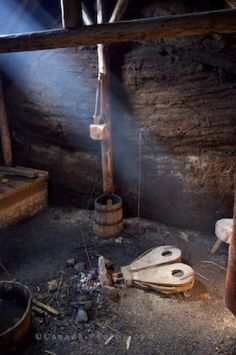 Photo of the interior of the reconstructed Smithy  Sod Hut at L'Anse Aux Meadows, Newfoundland.