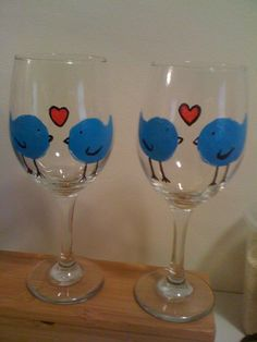 wine glasses from the dollar store and acrylic paint. So easy and fun! Great gifts :)