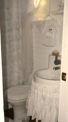 The bathroom, closed by a screen door, is plenty big enough for a miniature bathtub and, of course, more rustic frills.