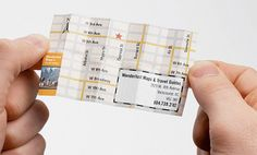 Unusual business card designed for Wanderlust folds into a miniature map.