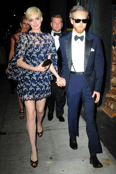 Anne Hathaway changed into a short blue lace dress to attend the Met Ball after-party at New York's The Standard hotel.