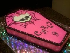 better picture of coffin cake..put a cute saying from monster high on there too..then add cupcakes...