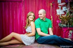 San Diego Wedding Photographers: Engagement Photo Shoot against bright red wall