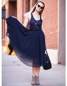 A model shows her softer side in a layered chiffon skirt. (NY Fashion Week)