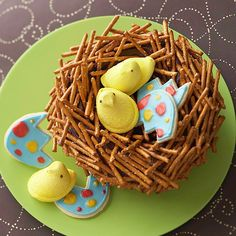 Bird's Nest Cake  This adorable bird's nest cake is a snap to make. Pretzel sticks create the nest's branches, while marshmallow candies make precious baby chicks. Sugar cookies are decorated to resemble the eggs.