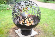 Sperical Firepit With Orchid Theme - less ordinary garden ideas