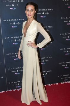 Alicia Vikander in a Louis Vuitton cream long-sleeved gown with a leather bodice.