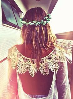 blue floral crown with a backless lace dress
