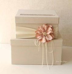 This nude peach wedding card box ($102) with the dusty pink flower would be a pretty addition to your nuptials.
