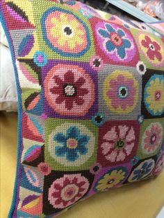 Magic Flowers needlepoint cushion, with teal piping.
