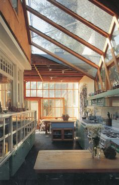 The glass cabinet on the left- could use an inexpensive glazed panel door tipped on its side. Good for display cabinet for workroom. Gehry House - Frank Gehry