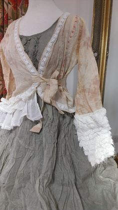.What a unique and special pairing...of the delicate rosy pink overtop, the sweet and tender dove-charcoal grey and the clean white of the ruffled long cuffs.  This is an amazing piece of creativity.