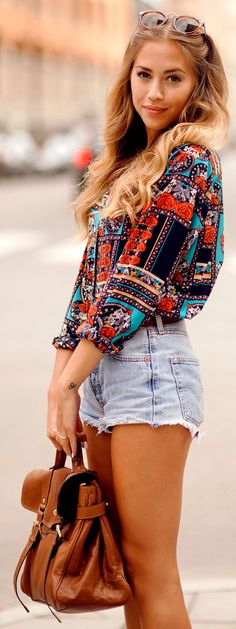 Printed blouse and jean shorts.