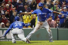 The Jays' Dalton Pompey celebrates with Devon Travis after scoring the game-winning run on a sac fly by Ezequiel Carrera Saturday night at Fenway. Oct 1, 2016