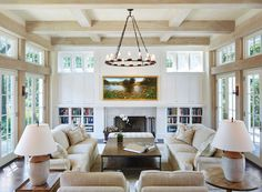 In the living room, daylight streams in from the French doors and clerestory windows that surround the space.