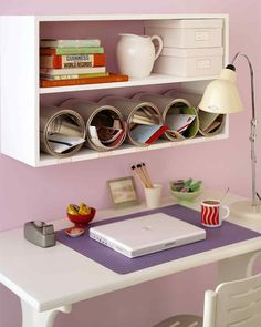 Don't let your desktop disappear under piles of paperwork. Inexpensive, unused cans can be purchased at paint stores; lined up on a shelf and anchored in place with Velcro, they become organizing cubbyholes with a modern flair. Assign cans as storage spaces for bills, catalogs, and personal mail, or one for each member of the family. Label the shelf beneath to make sorting easy.