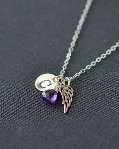 Infant Loss Necklace with February's birthstone amethyst, handstamped initial charm, and sterling silver angel wing.  Memorial keepsake jewelry by Blue Room Gems.