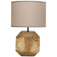 Natural and geometric styles collide to create Noir's Loraine table lamp. Crafted from natural hardwood for rustic appeal, this rounded light fixture boasts a faceted design for a modern dose of dimension. A textured beige drum shade continues the understated look. 14in W x 14in D x 23in H; Teak wood; Accepts one 40 watt max E26 bulb (not included); Includes 6ft vinyl insulated electrical cord; Inline rocker switch