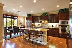 Really like this...granite counter tops, nice dark wood cabinets, lots of natural light, pretty floor