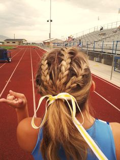 Braids...this would be cute for volleyball games and track meets! :)