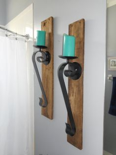 Pair (2) of Large, Authentic, Rustic Wood and Wrought Iron Scroll Candle Holders. Perfect for your Rustic/Cabin or Shabby Chic/Beach Living and Wall Decor. Each wrought iron scroll candle holder measures 20 inches tall and is mounted via hook and screw (it is removable for easy cleaning, etc) to a 5 W x 32 L plank of authentic, solid aged wood. The candle base area measures 5 wide which can accommodate a large candle. Candles not included. Feel free to convo me with any questions or offers…