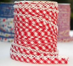I don't know what I'd make with this, but I love gingham and I love bias tape.  Bias Tape  Double Fold  Red Gingham Cotton by HollandFabricHouse, $1.75