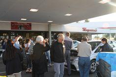 Customers gather around vehicle displays