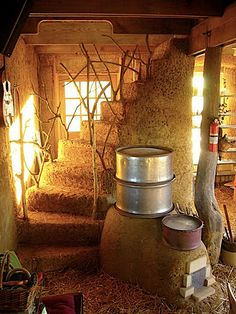 Here's a beautiful cob staircase and rocket stove under construction from Mark Mazziotti, in his straw bale house at Red Earth Farms.