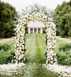 Create the arch of your dreams for party or wedding with a metal arch and plenty of flowers! x Decorative Metal Wedding Arch - White Metal Wedding Arch, Wedding Arbors, Metal Arch, Garden Wedding, White Wedding Arch, Lily Wedding, Wedding Entrance, Floral Wedding, Simple Church Wedding